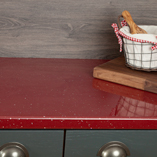 Using our red sparkle worktops with dark colours is an effective design technique.