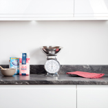 With a round edge, this Megara marble laminate worktop has been installed atop minimalistic kitchen cabinets.