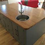 This small circular stainless-steel sink works perfectly in a kitchen island without taking up too much space.