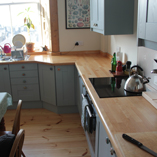 Solid beech worktops make a striking and charming addition to any kitchen.