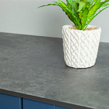 Solid laminate Magma worktops have a grey surface that looks similar to slate or concrete - perfect for an industrial-style kitchen.