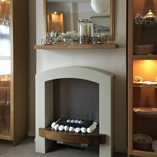 Our solid wood floating shelves make the perfect mantelpiece above decorative hearths.