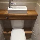 Customers have used our solid wood shelves in a variety of circumstances, including this micro toilet.