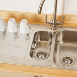 1.5 bowl stainless-steel sinks complement the standard bamboo worktops perfectly.