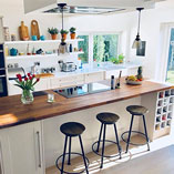 This stunning kitchen has an airy feel which is punctuated by the wonderful American walnut worktop used on the island in the centre.
