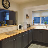 This stunning kitchen showcases the authentic qualities of our Colmar Oak laminate worktop.