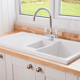This traditional Reginox Ceramic Sink with Drainer works beautifully with the solid ash worktops.