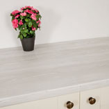 Walls painted in light colours along with pale cabinet frontals combine well with our Cascina Pine worktops.