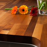 Walnut worktops are smooth and incredibly hard-wearing - perfect for kitchen surfaces.