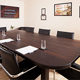 A large wenge worktop was fabricated to create the table in Worktop Express's primary meeting room.