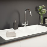 White cabinets and sinks perfectly complement the finish and colour of our Anthracite Grey super matt worktops.
