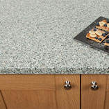 The melange of white, grey and black shades on this worktop create a striking granite look.
