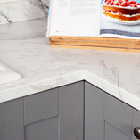 Our white marble laminate worktops are an affordable way to update your kitchen.