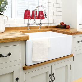 A glossy Belfast sink is a popular choice for traditional kitchens.