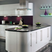Glossy white cabinets are a perfect match for creating a high-contrast kitchen with our Black Sparkle worktops.