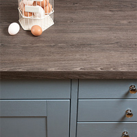 Grey oak laminate worktops replicate the look of hardwood timber surfaces and have a clean square edge profile.