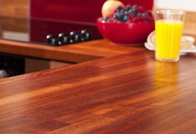 Solid iroko kitchen worktops with 40mm staves, joined with a butt joint.