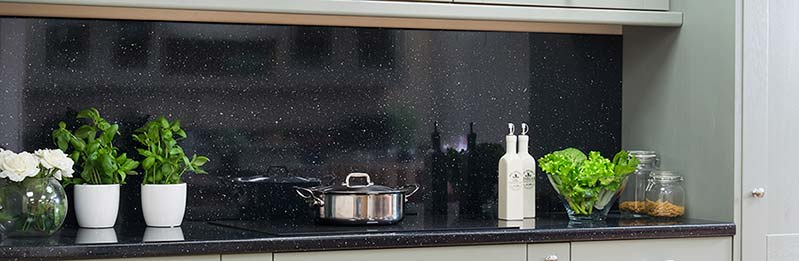 Our glossy black sparkle laminate splashback is a striking addition to any kitchen.
