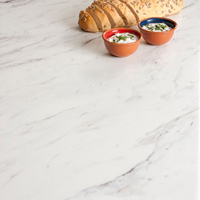 Calcutta Marble laminate worktops look superb alongside any hardwood timber, particularly dark options.