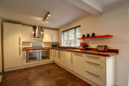 Matching worktop upstands serve to blend a worktop seamlessly into the kitchen walls.