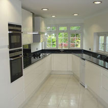 The monochrome look is a perfect kitchen theme for complementing Black Sparkle laminate worktops.