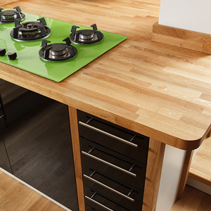 Oak worktops on an irregular kitchen island with overhang