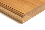 This charming ogee edge has been paired with a pencil profile on the bottom edge of the wooden countertop