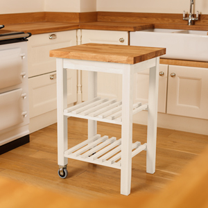 Our painted kitchen trolley has a beech frame painted in Farrow & Ball's New White, and a traditional oak worktop.
