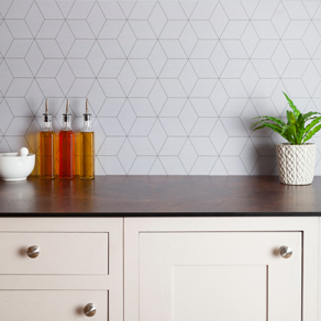 This white geometric tile splashback has a contemporary hexagonal pattern suitable for a contemporary kitchen