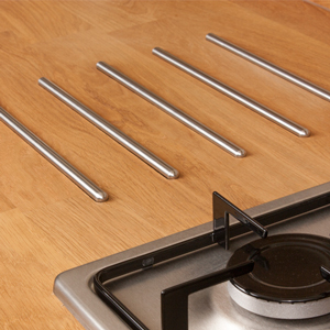 Protect your solid wood kitchen counter with stylish stainless steel hotrods.