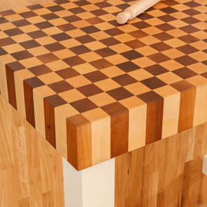 Rectangular butcher blocks are an ideal food preparation space for the end of a kitchen island.