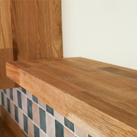 Solid oak floating shelves are a versatile, robust and attractive choice to complement timber worktops.