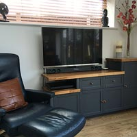 A TV stand made out of lengths of our solid wood worktop