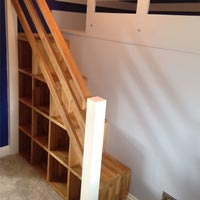 A staircase made from wooden worktops