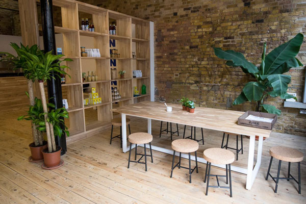 This table and matching set of shelves was made by Goldfinger Factory using our wood worktops for Pamban Café in Camden market.