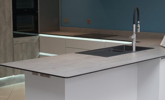 Thin, grey solid laminate worktop in modern kitchen setting
