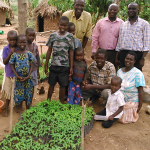 Okiror John Chris, Tasuma Suzan and family with the tree nursery they own thanks to the support of VEFO and ITF.