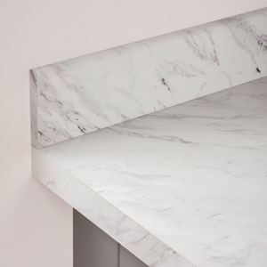 Matching white marble accessories can help to blend your new worktop into modern marble kitchen designs.
