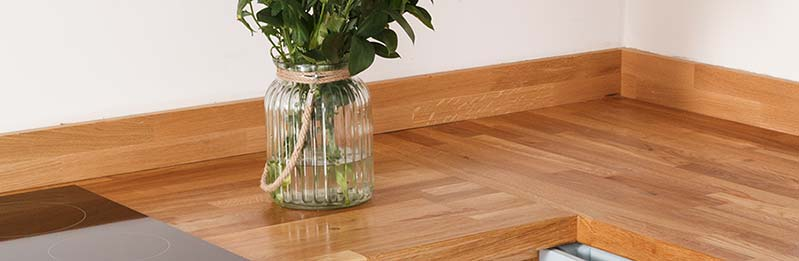 Pair oak worktops with oak upstands for a sleek, stylish look.